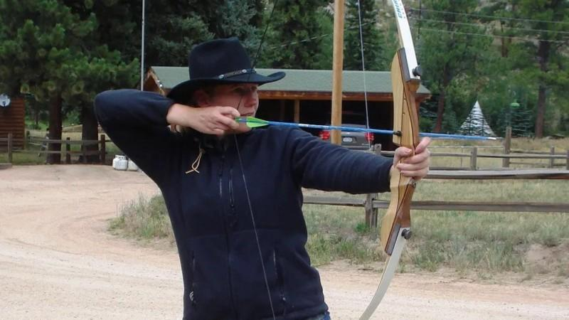 Woman hones her archery skills with a recurve bow